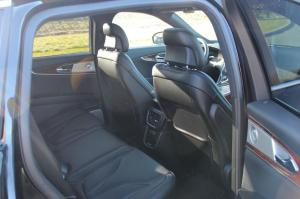 Back seat of Lincoln MKX with black leather.